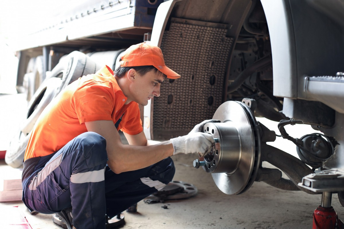 Mechanic working on the brakes of a truck